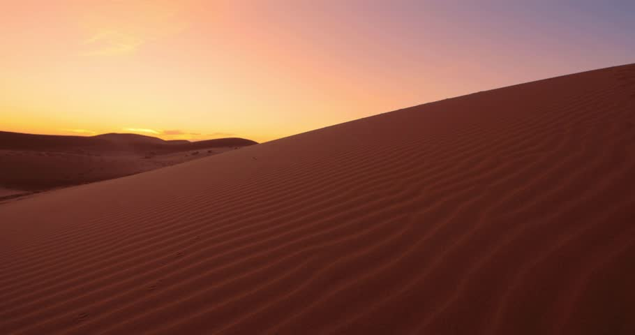 woman climbing a sand dune in the desert at sunset fiery. #15701947