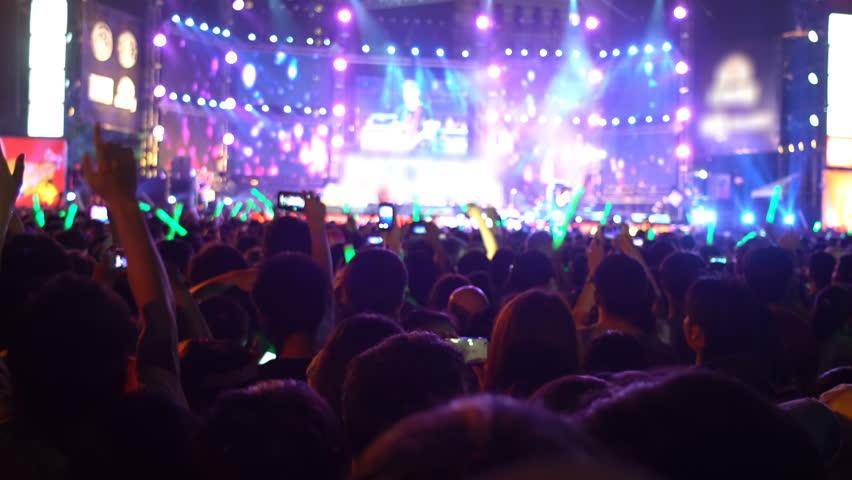 Fans chearing at open air concert. 4k UHD (3840x2160)  #15716917
