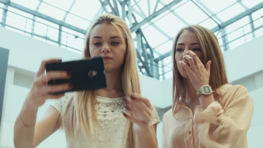 ZAPOROZHYE, UKRAINE - JANUARY 15, 2016: Avrora city mall. Girlfriends do the selfie in entertainment shopping center   Shutterstock HD Video #15731257