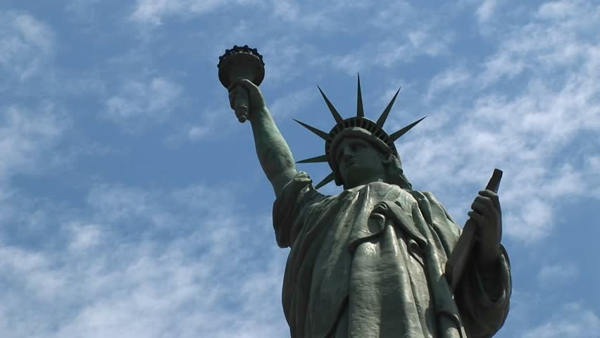 Statue of Liberty stands tall against blue sky circa 2006 in New York. | Shutterstock HD Video #1573162