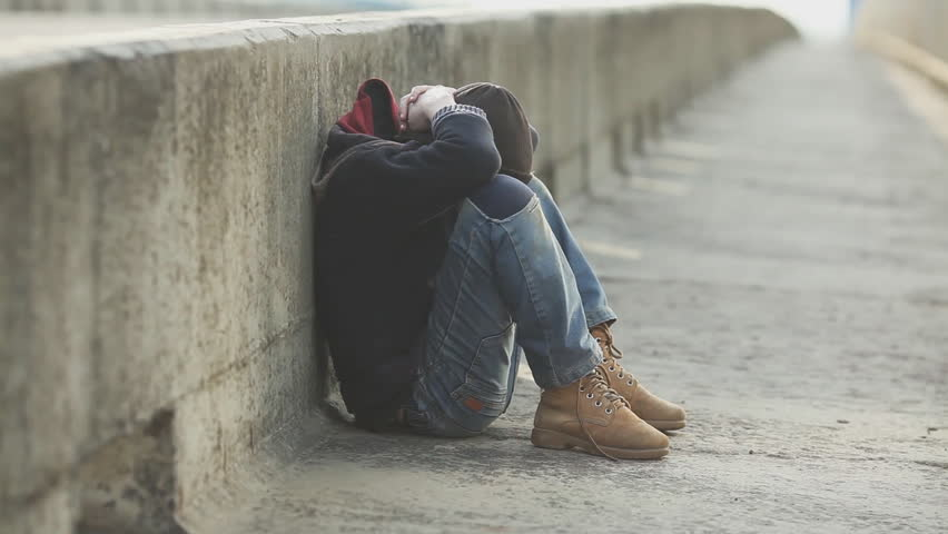dramatic portrait of a little homeless boy on the bridge, poverty, city, street