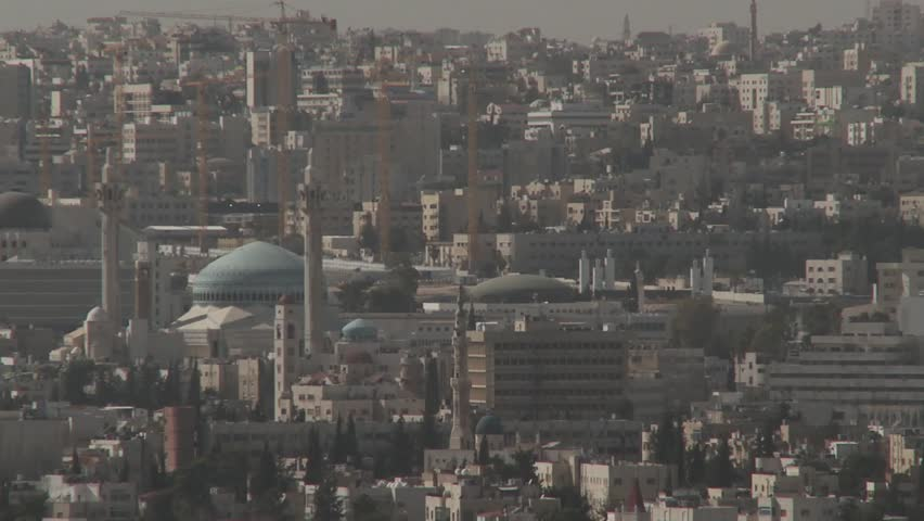 Amman, Jordan cityscape, tilt up to kite flying high above
