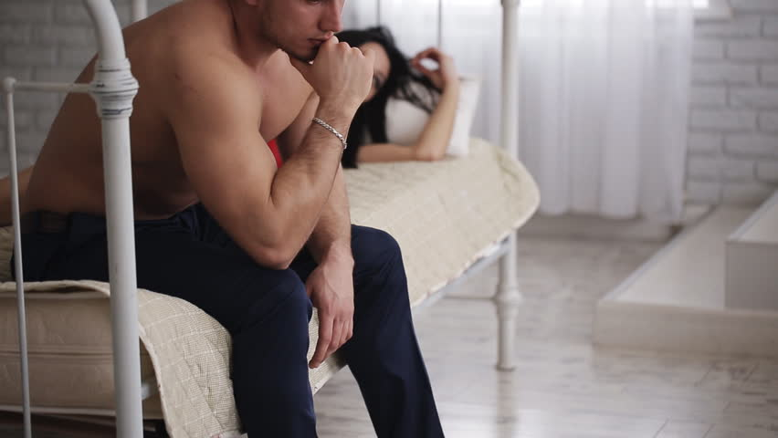 Family problems. Upset young couple having problems with sex.