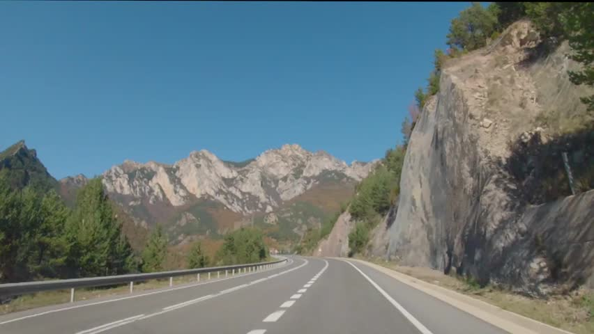 Gopro car footage of mountain pass, Spanish Pyrenees mountains grove ahead. Road to Andorra.