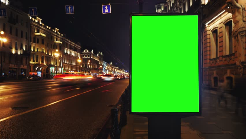 A Billboard with a Green Screen on a Busy Night Street.Time Lapse. #15819577