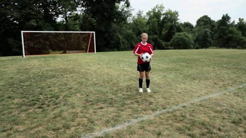 July 21, 2010: Girl practicing soccer skills