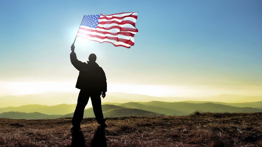 Successful silhouette man winner waving USA United States of America flag on top of the mountain peak, 4k cinemagraph #15898507