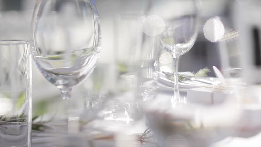 Empty glasses for wine and water set on a festive table in a restaurant – focus shift of glassware. Table decoration