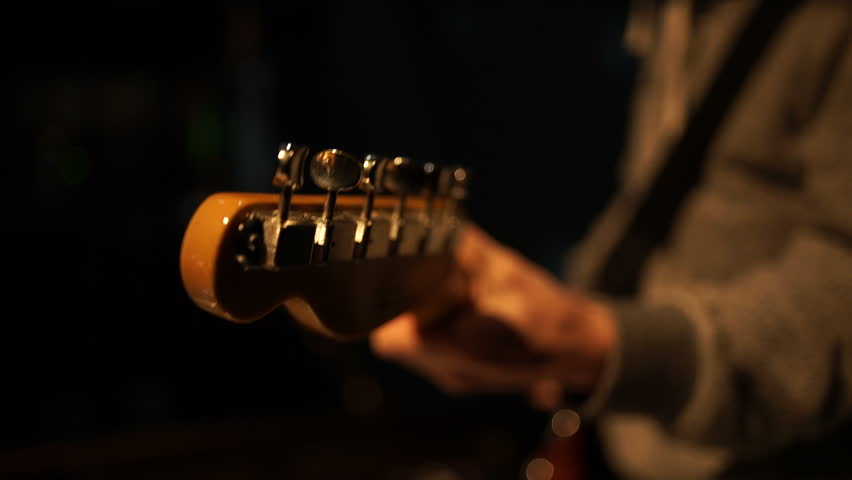Stage ambient on a concert. Man playing guitar. | Shutterstock HD Video #15974197