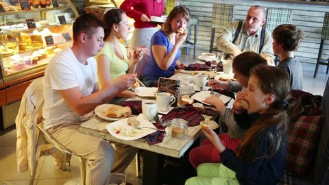 SAMARA - MAY, 8, 2015: Children and adults are eating and drinking at table in cafe next to counter. Attendance restaurants in Samara fell to 20 percent last year, while prices rose by 10-25.