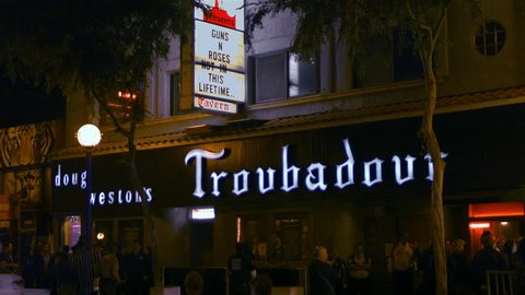The scene outside the Troubadour rock and roll nightclub with Guns N Roses name on the marquee in West Hollywood, Ca on April 1 2016.