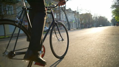 male employee goes to work by bicycle in the morning slow motion