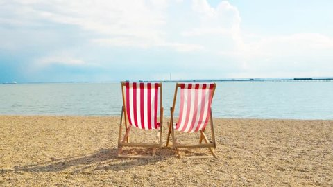 Two solitary deck chairs on the beach,. This was taken Southend on Sea Essex circa April 2016.