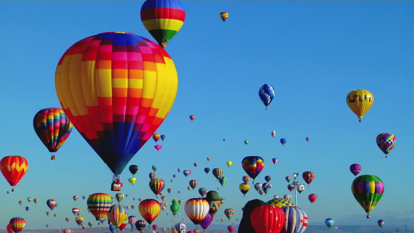 Balloons float across the sky at the Albuquerque Balloon Festival