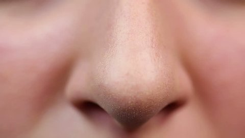 Closeup view of nose, reception at cosmetician. Enlarged pores, skin problems