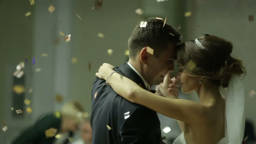 Beautiful Brunette Bride And Handsome Groom Dancing First Dance At The Wedding Party Confetti In Air Very Tender Moment Stock Footage Video 16053757