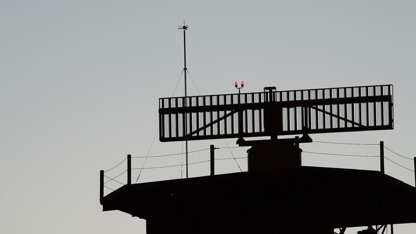 Radar turning in tower of telecommunications in airport at sunset   Shutterstock HD Video #16102897