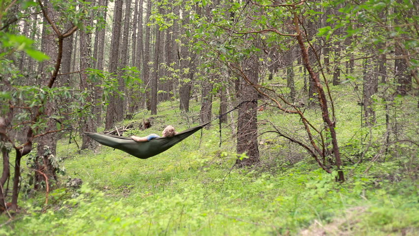 A looping video of a person relaxing in nature | Shutterstock HD Video #16113307