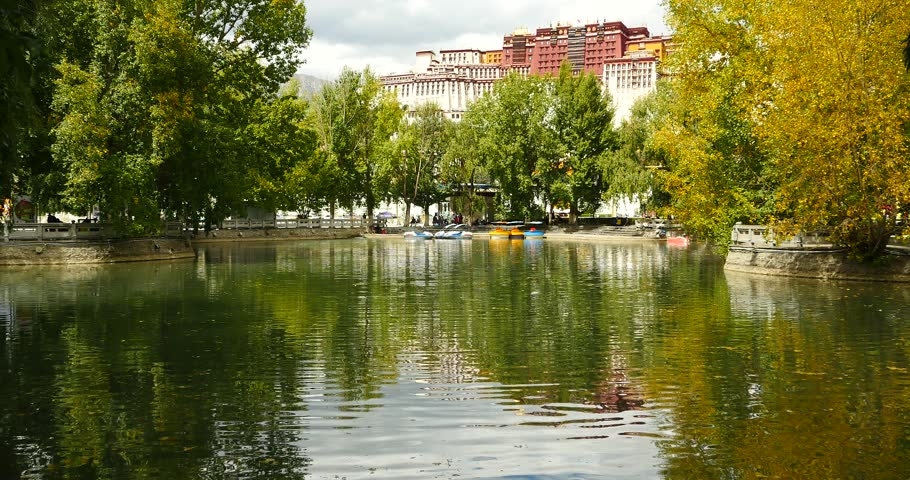 4k Potala reflection on lake in Lhasa park,Tibet.lake with tree in autumn.. gh2_09797_4k