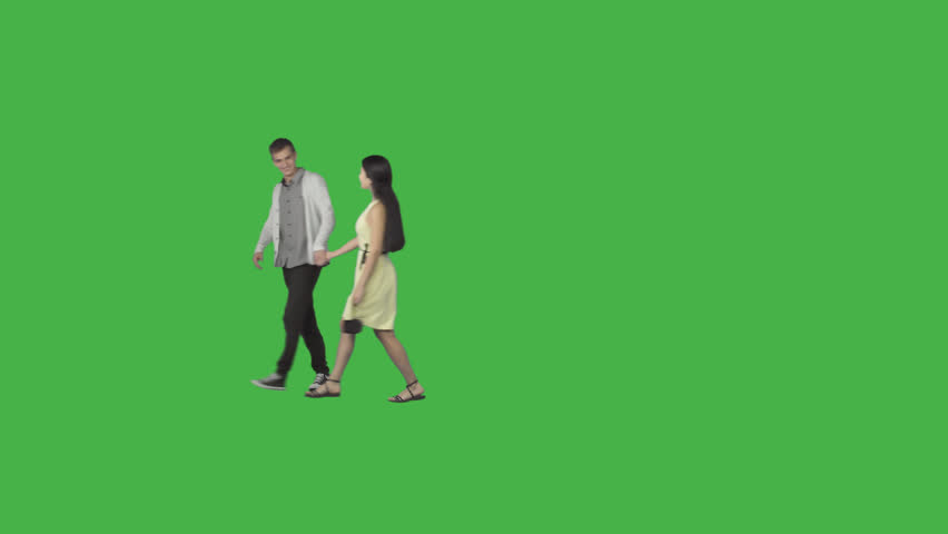 Guy & asian girl in yellow dress walks holding on hands. Footage with alpha channel. File format - .mov, codec PNG+Alpha. Shutter angle -180 (native motion blur)