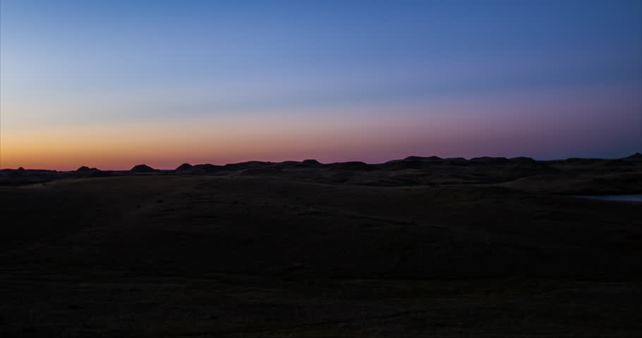 Timelapse of colorful sunrise over a prairie hill scape on a Montana summer morning - 2015 Sept12 7D02100 TL