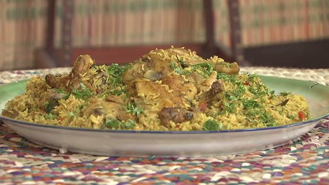 Arabic Food. Cu shot of a steaming dish of Mandi made with mutton, a traditional dish from Yemen but popular throughout the Gulf.