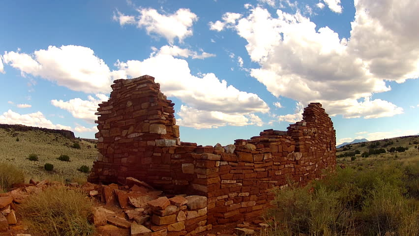 FLAGSTAFF, ARIZONA/USA- June 15, 2015- A 10 second time lapse shot of big puffy clouds drifting over the ruins of an ancient Sinagua Native American Indian pueblo on the Arizona high desert plateau.