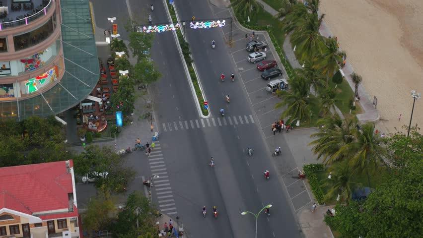 Aerial view of a city street near the sandy beach. Nha Trang, Vietnam | Shutterstock HD Video #16171927