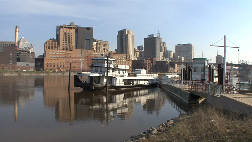 October - 2011 - St. Paul, Minnesota - Boardwalk with barges on the Mississippi River
