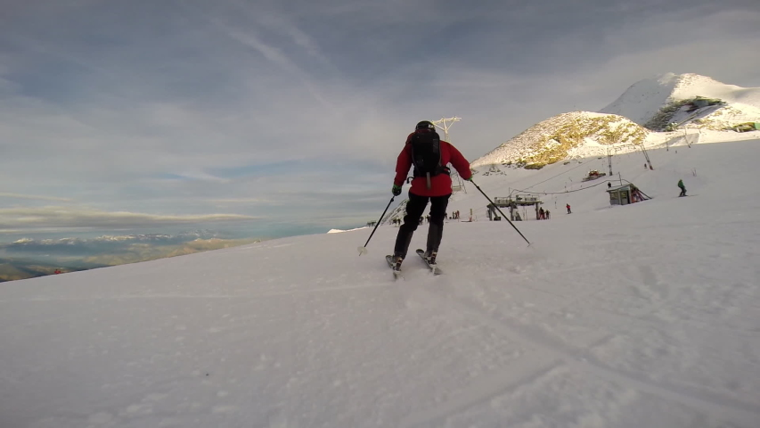 Young man skiing down a snow covered mountain. - Slow Motion - Model Released | Shutterstock HD Video #16186147