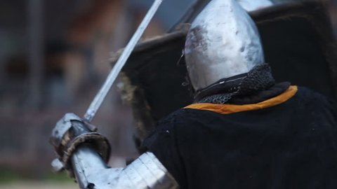 Battle between two aggressive and strong opponents, medieval knights slowmotion. Armed men fighting , ancient warriors competition, historical show outdoor. Real combat simulation, male dispute, power