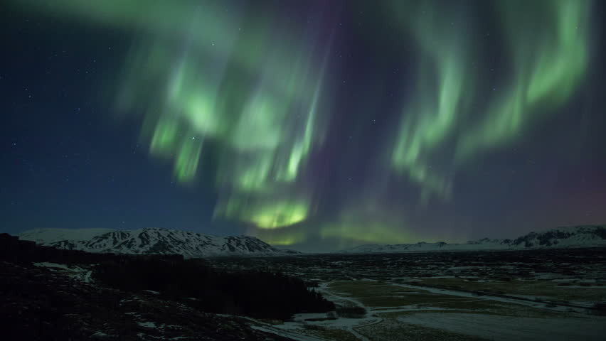 Bright aurora borealis northern lights realistic movement snowy mountains Iceland 4k | Shutterstock HD Video #16212424