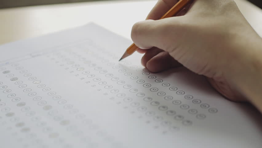 Student filling out answers to a test with a pencil | Shutterstock HD Video #16225822