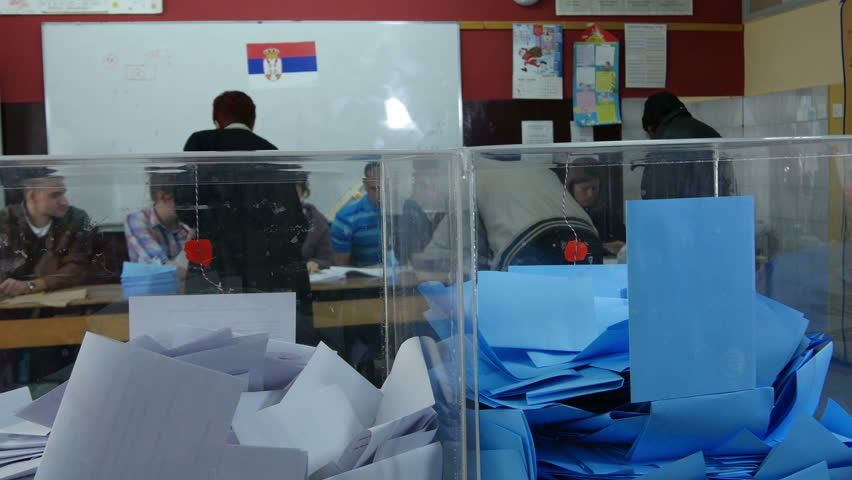 Krusevac,Serbia,24.04.2016. Parliamentary elections. Man vote on elections, people put ballot in boxes, voting close up, tilt down, commission checking identity of voters. Civic duty, insert, indoor.