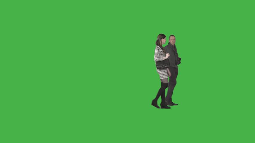 Male & brunette girl walks together on transparent background. Footage with alpha channel. File format - .mov, codec PNG+Alpha. Shutter angle -180 (native motion blur). 50 mm lens