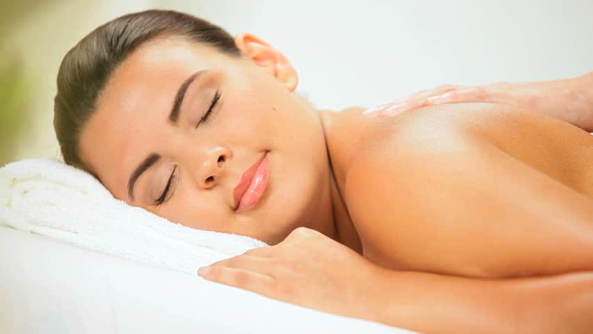 Beautiful Girl Enjoying Massage Treatment