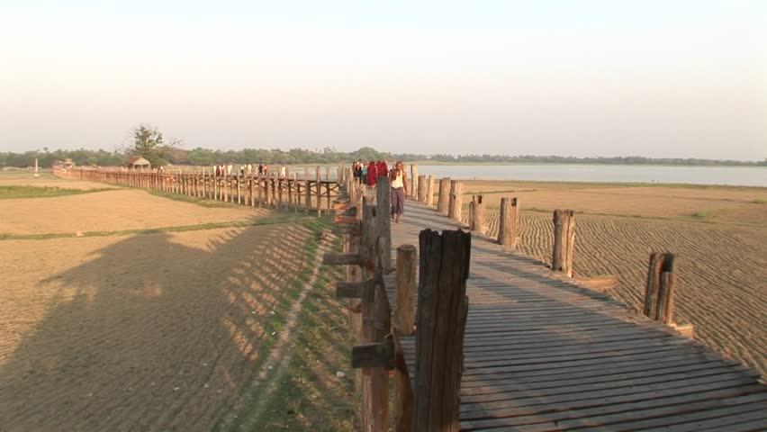 A villager wanders down a boardwalk.