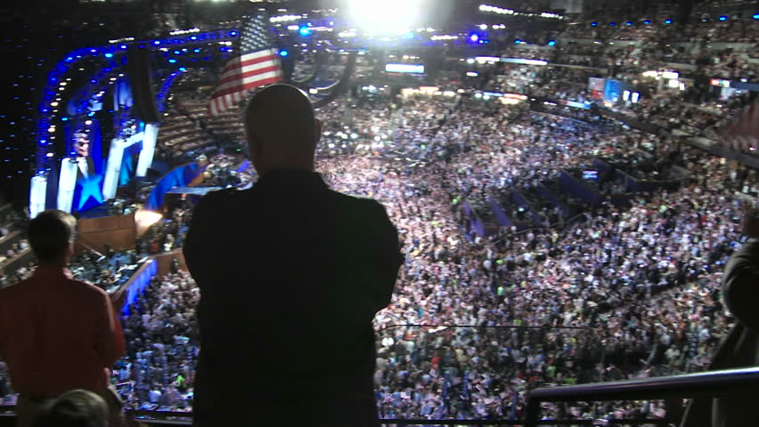 DENVER, COLORADO - CIRCA 2008: A packed stadium at Pepsi Center clap and cheer as Bill Clinton delivers a pro-Barack Obama speech at the 2008 Democratic National Convention.