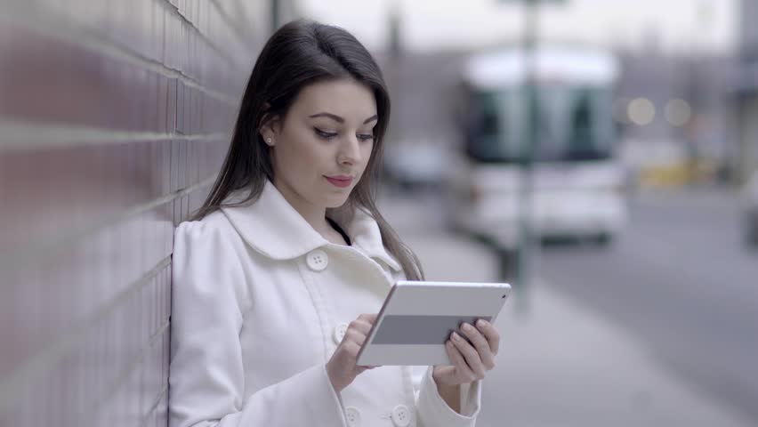 Young attractive caucasian women standing on sidewalk street using tablet computer browsing the internet online. urban city lifestyle background | Shutterstock HD Video #16363237