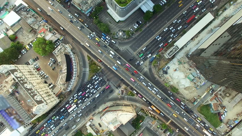 aerial top view of traffic and vehicle car on crossroad or junction in bangkok city area at twilight sunset, 90 degree shot, High quality footage 4K