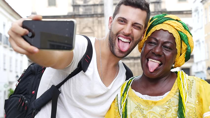 Tourist taking a selfie with a Baiana in the old colonial district of Salvador, Brazil | Shutterstock HD Video #16414714