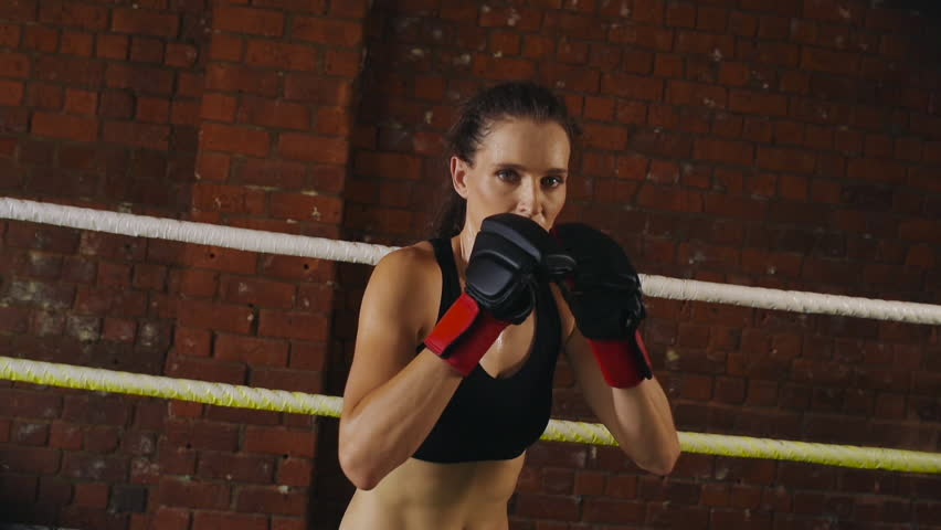 Woman training gym boxing mma ring shadow boxing mixed martial arts man woman training gym boxing mma ring pads mixed martial arts fitness hd stock video thecheapjerseys Gallery