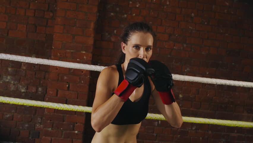 Woman training gym boxing mma ring shadow boxing mixed martial arts woman training gym boxing mma ring shadow boxing mixed martial arts fitness hd stock video altavistaventures Choice Image