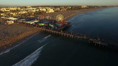 Aerial shot of Santa Monica pier and beach - Los Angeles, California, 2016. Beautiful tropical sunset!