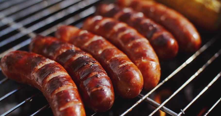 Tasty juicy sausages grilling over a fire | Shutterstock HD Video #16470616