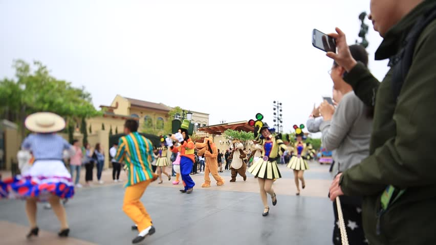 Shanghai,China-May 7th,2016:The street parade at Shanghai Disney land  where all you favorite Disney characters come out to greet awaiting fans.Disney trial operation from May 7th 2016