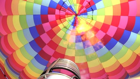 Activating the propane burner, Interior of a hot air balloon, burners are located directing the jet of fire toward the entrance of the envelope. 4K