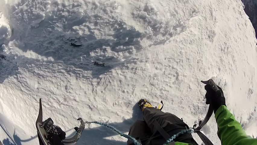 POV of mountain climbing in the snow using crampons and ice axes. - Model Released - HD
