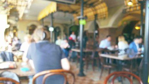 People in restaurant interior, blurred background
