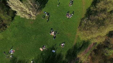 Top view of people resting in the spring park and making barbecue at May weekend, St. Petersburg, Russia